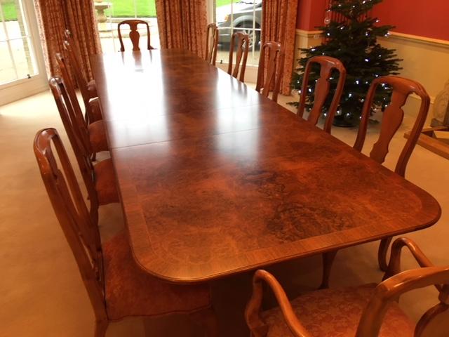Walnut veneered dining table
